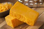 Organic Sharp Cheddar Cheese — Stock Photo