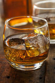 Alcoholic Whiskey Bourbon in a Glass with Ice — Stock Photo