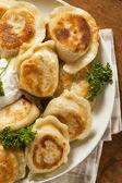 Homemade Polish Pierogis with Sour Cream — Stock Photo