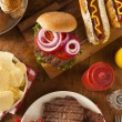 Grilled Hamburgers and Hot Dogs — Stock Photo #48733333