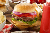 Hearty Grilled Hamburger with Lettuce and Tomato — Stock Photo