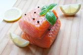 Salmon with basil and lemon — Stock Photo