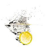 Fresh lemon slice splash — Stock Photo