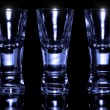 Three shot glasses empty - Foto Stock