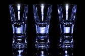 Three shot glasses empty — Stock Photo