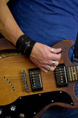 Rock posturing abd guitars — Stock Photo