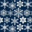 Crochet snowflakes seamless pattern on dark blue, vector — Stock Vector