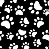 Paw footprints of a dog or a cat seamless pattern in black snd white, vector — Stock Vector