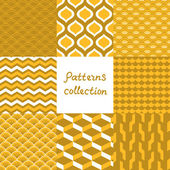 Abstract art deco geometric seamless patterns set in shades of gold, vector — Stockvector