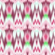 Colorful tie dye ethnic geometric fabric seamless pattern in pink and white, vector — Stock Vector #29028277