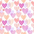 Colorful red and pink striped hearts on white seamless pattern, vector — Stock Vector