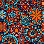 Colorful circle flower mandalas seamless pattern in blue red and orange, vector — ストックベクタ