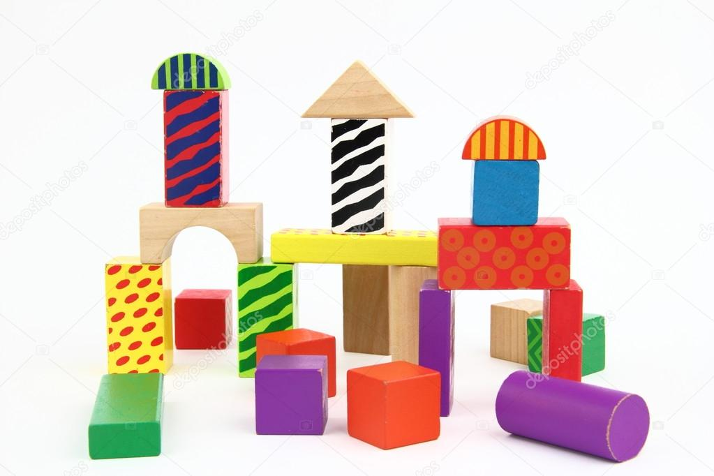 Wooden building blocks on the white background — Stock Photo #13342342