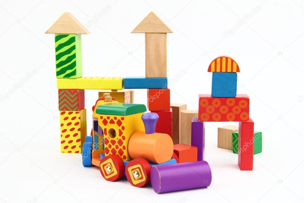 Wooden building blocks on the white background  Stock Photo #13342361