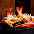 Foto Stock: Grilling lobsters