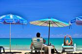 Sitting on the beach — Stock Photo