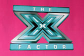X-Factor logo — Stock Photo