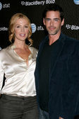 Poppy Montgomery & Husband — Stock Photo