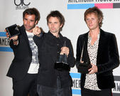 Muse - Christopher Wolstenholme, Matthew Bellamy and Dominic Howard — Stock Photo
