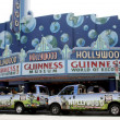 Guiness Museum and Hollywood Tour Buses - Stock Photo
