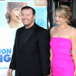 Ricky Gervais &amp; Wife - Stock Photo