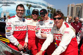 Tim Daly & Eric Close with their racing instructors — Stock Photo