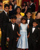 Children who played various ages of the Slumdog Millionaire chilhood — Stock Photo