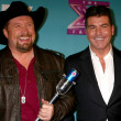 Stock Photo: Tate Stevens - Winner of 2012 X Factor, Simon Cowell