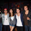 Постер, плакат: Kendall Schmidt James Maslow Carlos Pena Jr and Logan Henderson of Big Time Rush with Victoria Justice