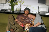 Kiko Ellsworth & Christine Carlo, with their dog — Stock Photo