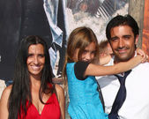 Gilles Marini, wife, daughter (blue), friend — Stock Photo