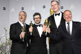 Sound editors Skip Lievsay, Niv Adiri, Christopher Benstead, and Chris Munro, winners of Best Achievement in Sound Mixing — Stock Photo