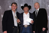 Bob Romero, George Strait, Jerry Jones — Stock Photo