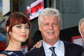 Olga Kurylenko, Roger Donaldson — Stock Photo