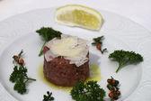 Carne cruda with parmesan — Stock Photo