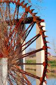 Waterwheel in the river — Stock Photo