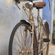 Old bicycle parked — Stock Photo