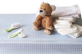 Changing table with a teddy bear — Stock Photo