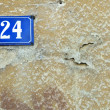 Stock Photo: Vintage background number twenty four in old wall