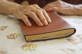 Old woman holding book — Stock Photo