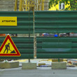 Stock Photo: Metal fence with under construction sign