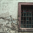 Old dirty window on old cracked wall - Stock Photo