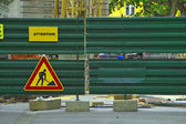 Metal fence with under construction sign — Stock Photo