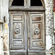 Door of an old abandoned building - Stock Photo