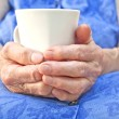 Stock Photo: Senior hand hold cup of tea