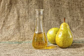 Yellow pears and pear brandy — Stock Photo