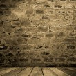 Stock Photo: Old brick wall with wooden floor