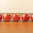 Red apples on table — Stock Photo