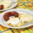 Fried eggs and sausage — Stock Photo