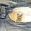 Money in blue jeans — Stock Photo